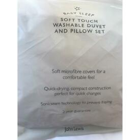 New unused Cot duvet and pillow set from John Lewis