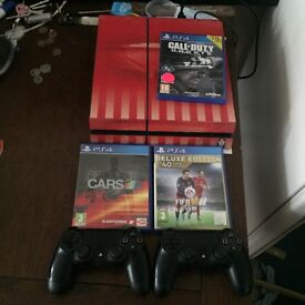 PS4 with controllers and games for sale