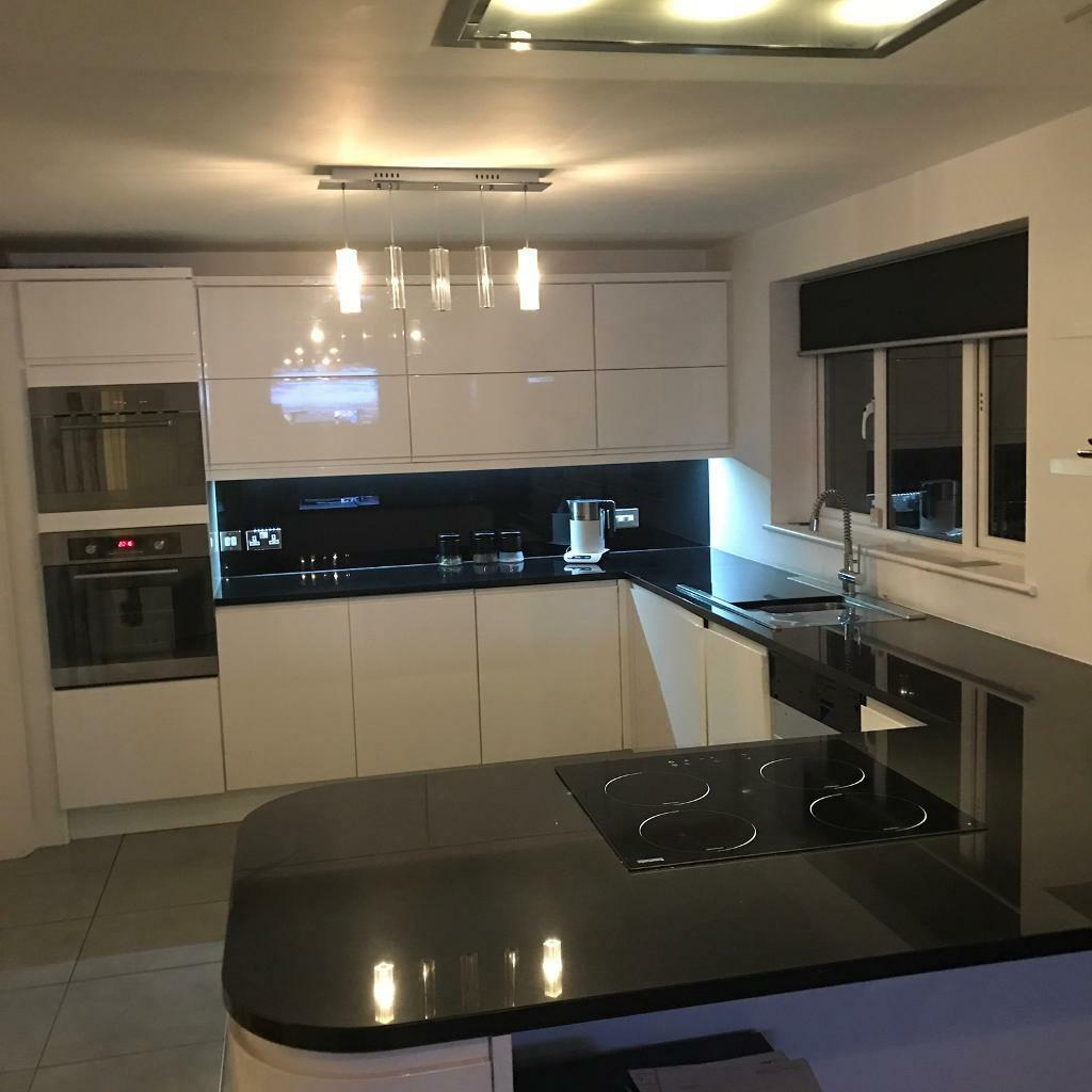 White gloss kitchen with black granite worktops | in Allestree ... on black with white kitchen floor, black with white doors, black with white drawers,