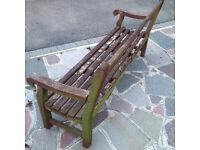 Vintage teak slatted garden bench stamped Lister, Dursley, Glos. circa 1974, in fair condition, 1.8m