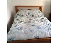 Solid wooden kind size bed frame.