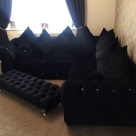 Black crushed velvet corner sofa and foot rest