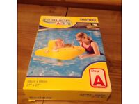 Brand new, in box baby swim ring and seat.
