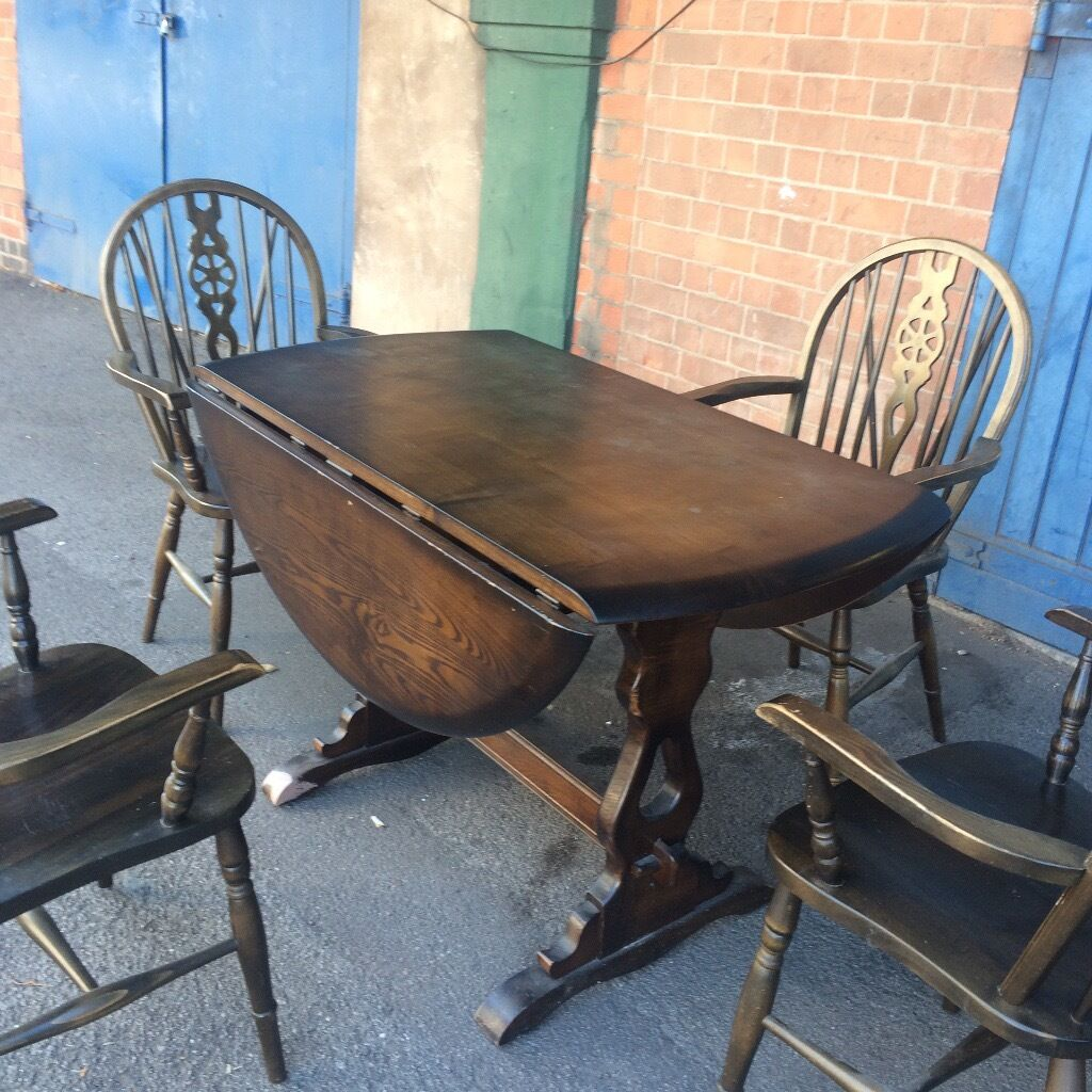 Windsor Extending Old Colonial circular dining Table and Four Carver chairs.