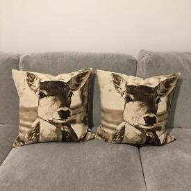 Set of 2 deer cushions only £12. RRP £60