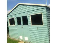 10 ft x 10 ft log effect shed/cabin