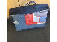 Breathable groundsheet. New in packing. Size 3.5 metres x 2.5 metres.