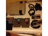 Nintendo NES console and 3 games in good condition