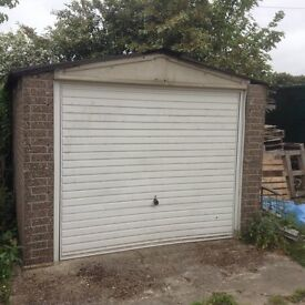 Prefabricated Garage with up and over door.