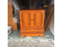 TV cabinet yew tree colour high gloss finish of v good quality.