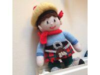 Hand knitted scottish man