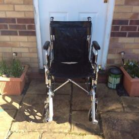 Black fold up wheelchair with footplates for sale £50.