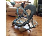 Teal baby bouncer in excellent condition.