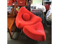 Designer lounge chair and foot stool. Contemporary design.