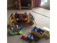 Peppa pig house, roundabout, caravan and figures.
