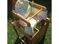 A wooden high chair coverts to chair and table