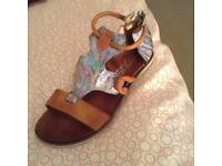 Stunning pair of leather sandals