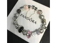 Pandora bracelet and charms (can sell separately)