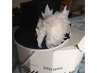 Black hat with white trim & flower