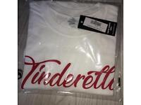 White tinderella t shirt size small and medium