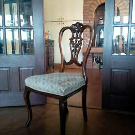 Dining Chairs with ornate carved back