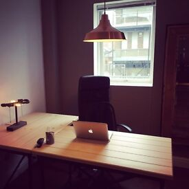 Desk in co-working space above Town Square Café & Bar