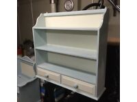 Lovely shelving unit , with two small drawers .