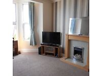 Two bedroom unfurnished first floor flat in Mileshouse with parking.