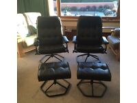 2 contemporary reclining swivel armchairs with matching footstools in black leather