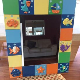 Mirror suitable for a child's or baby's room
