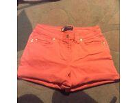 Shorts, size 8, salmon coloured