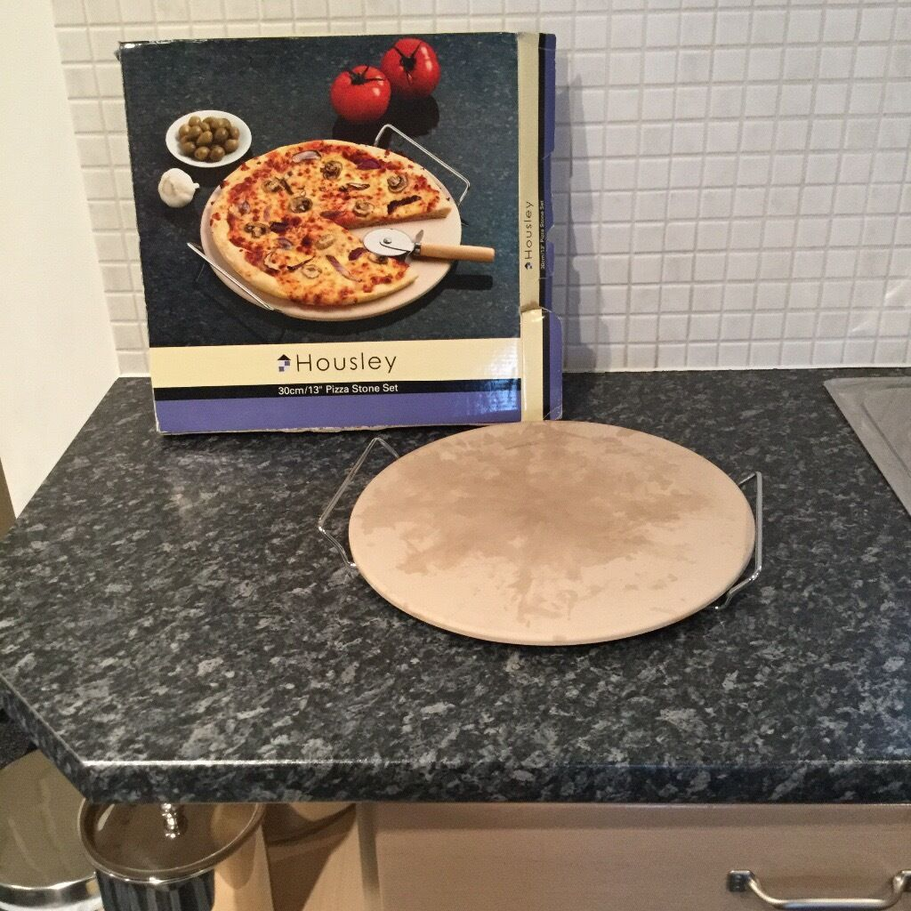 "Pizza stone set 30cm 13"" Brand Housleyin Kingswood, East YorkshireGumtree - Pizza stone set size 30cm/13"" with box. Please note there is marks on the stone due to use but only used a couple of times so still in good condition. The brand is Housley. Please note the pizza cutter is missing"