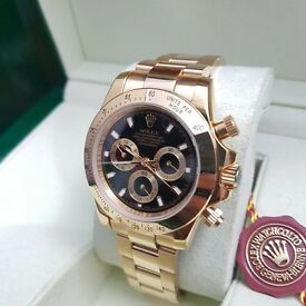 ..Men's Gold Rolex Daytona black face all gold bracelet complete set with Rolex box bag & paperwork