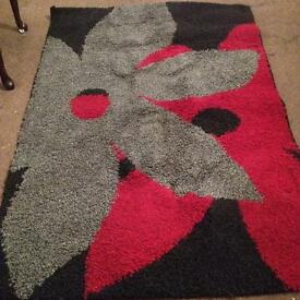 Red grey black rug £20 ono