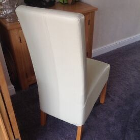 Cream leather effect dining room chairs