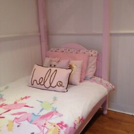 Pink four poster solid pine bed