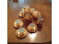 gold coloured coffee set