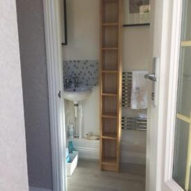Tall slim cd/bathroom unit