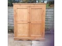 Pine cupboard with doors and two shelves