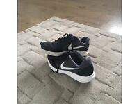 Boys black and white Nike trainers size 5