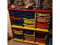 Storage unit with plastic drawers