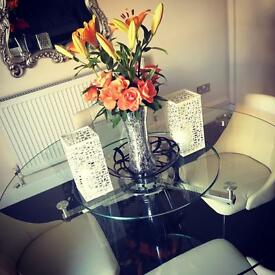 **Absolutely stunning** 1.3 m diameter glass table and 4 faux cream chairs