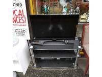 32 inch flat screen tv (HDMI ports etc ) with remote and black glass tv cabinit