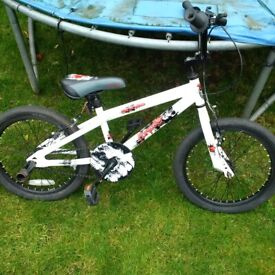 BMX bike with stunt pegs for small children