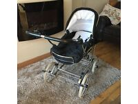 Churchill pram with pale blue accessories