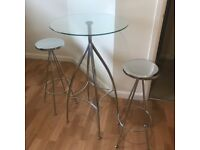 Bar table and two stools