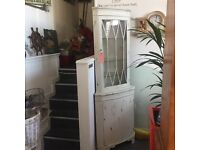 CORNER DISPLAY CABINET. QUALITY. SHABBY CHIC NICE FINISH. LIGHTS UP LOVELY.