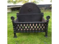 Large, ornate dog grate for open fire