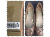 Beige court shoes, size 6 from Roman. Although I'm only a 5