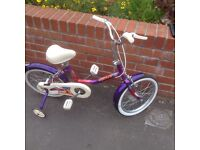 Girls purple, white and pink Raleigh bike with stabilisers and in good condition